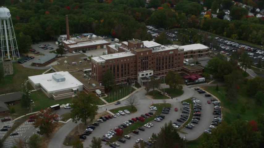 6K stock footage aerial video orbiting the Veterans Affairs Medial Center, autumn, Manchester, New Hampshire Aerial Stock Footage | AX152_037