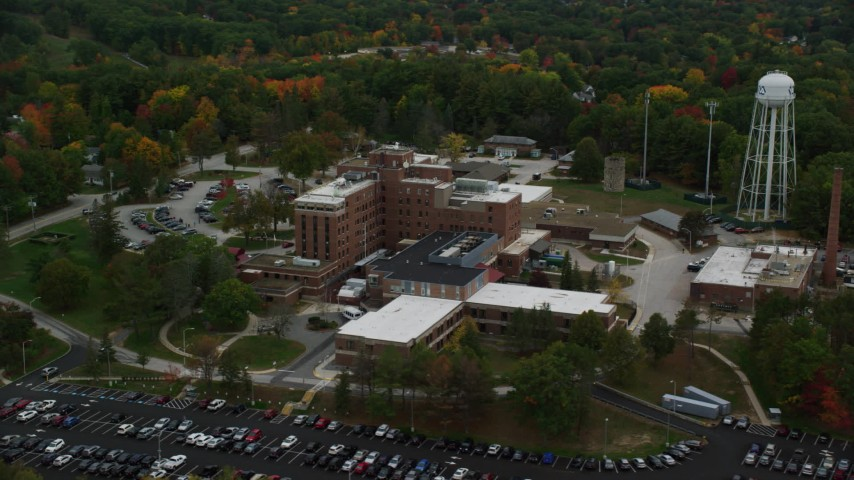 6K stock footage aerial video orbiting colorful foliage, Veterans Affair Medical Center, autumn, Manchester, New Hampshire Aerial Stock Footage | AX152_039