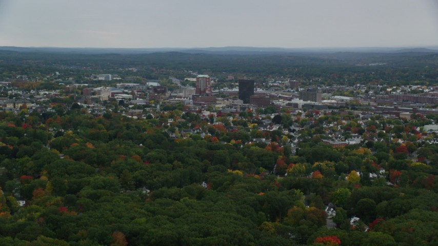 6K stock footage aerial video flying by downtown office towers, colorful foliage, autumn, overcast, Manchester, New Hampshire Aerial Stock Footage | AX152_040
