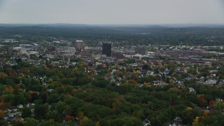 6K stock footage aerial video flying by downtown office towers, colorful trees, autumn, Manchester, New Hampshire Aerial Stock Footage | AX152_041
