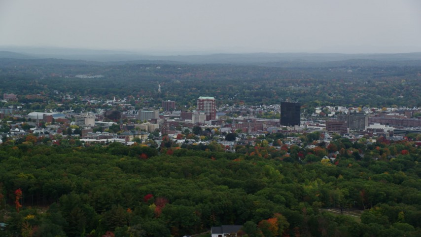 6K stock footage aerial video flying by downtown office towers, overcast skies, autumn, Manchester, New Hampshire Aerial Stock Footage | AX152_042