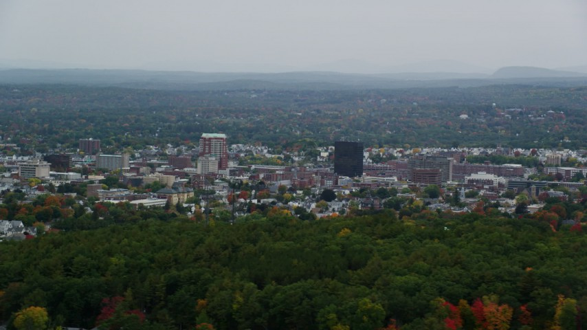 6K stock footage aerial video flying by office towers, downtown, overcast, autumn, Manchester, New Hampshire Aerial Stock Footage | AX152_043