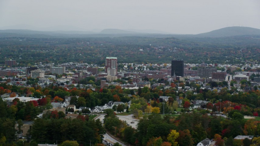 6K stock footage aerial video flying by office towers, colorful foliage, downtown, autumn, overcast, Manchester, New Hampshire Aerial Stock Footage | AX152_044