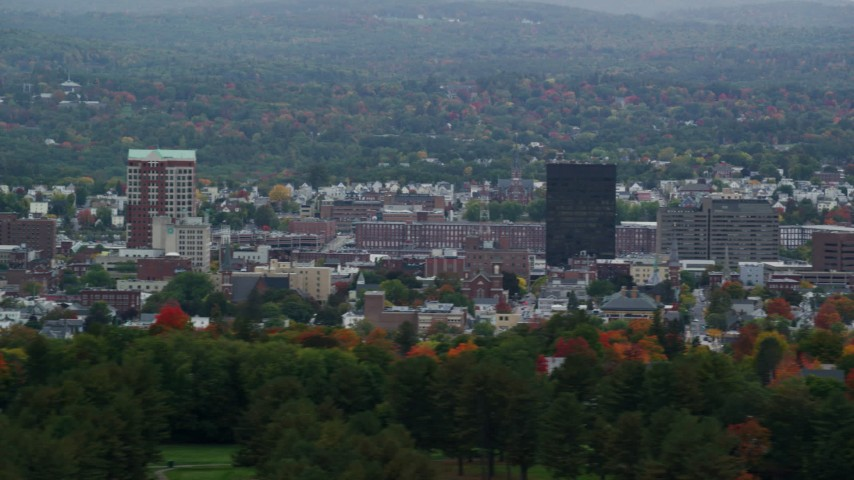 6K stock footage aerial video of City Hall Plaza, Hampshire Plaza, downtown office towers, autumn, overcast, Manchester, New Hampshire Aerial Stock Footage | AX152_045