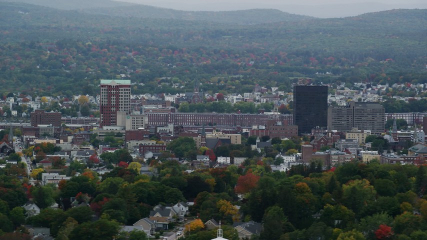 6K stock footage aerial video of Downtown towers, City Hall Plaza, Hampshire Plaza, overcast, autumn, Manchester, New Hampshire Aerial Stock Footage | AX152_046
