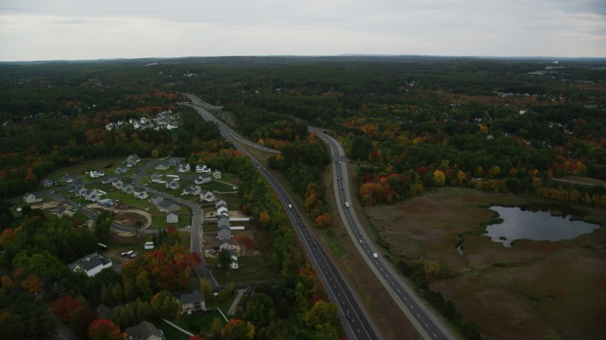 6K stock footage aerial video flying over Interstate 93, brightly colored foliage, autumn, Manchester, New Hampshire Aerial Stock Footage | AX152_048
