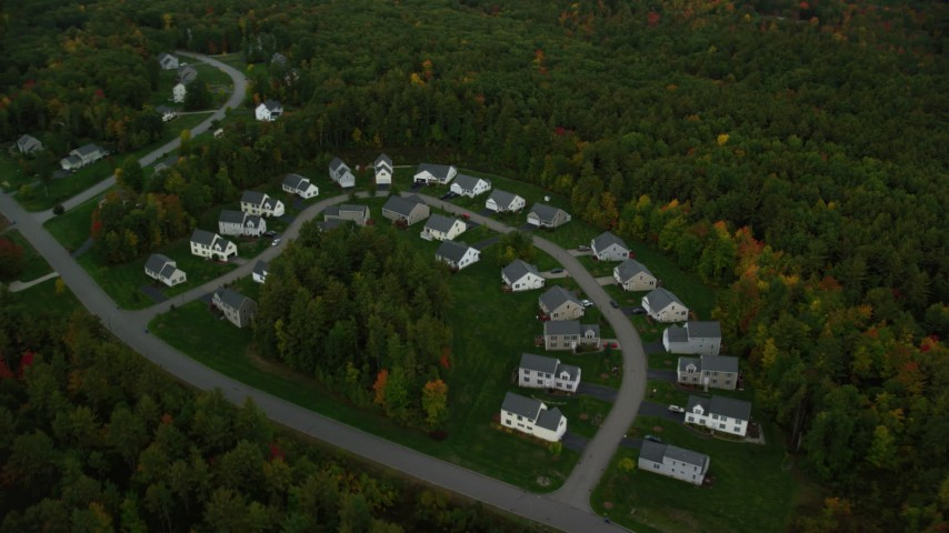 6K stock footage aerial video flying by tract homes, colorful trees in autumn, tilt down, Manchester, New Hampshire Aerial Stock Footage | AX152_050