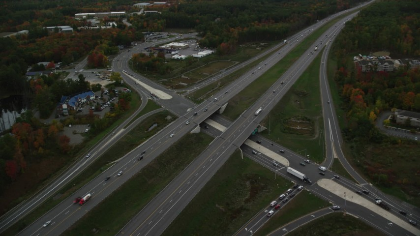 6K stock footage aerial video approaching Interstate 93 and tilt down, autumn, Londonderry, New Hampshire Aerial Stock Footage | AX152_053
