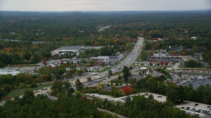 6K stock footage aerial video flying by car dealership, strip mall, Nashua Road, autumn, Londonderry, New Hampshire Aerial Stock Footage | AX152_054