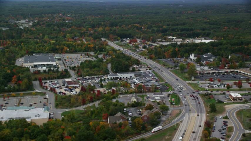 6K stock footage aerial video flying by car dealership, strip mall, Nashua Road, autumn, Londonderry, New Hampshire Aerial Stock Footage | AX152_055