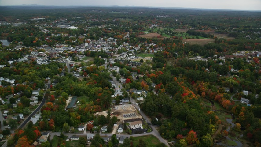 6K stock footage aerial video flying by homes, downtown area, colorful foliage in autumn, Derry, New Hampshire Aerial Stock Footage | AX152_056