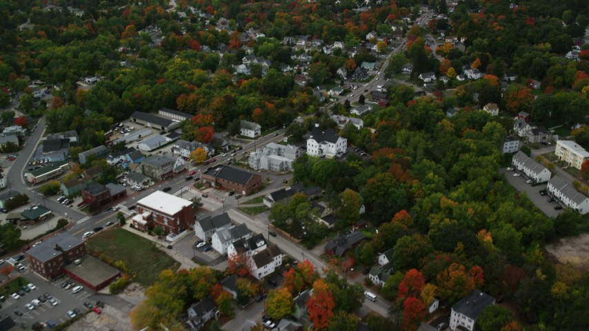 6K stock footage aerial video flying over Broadway, colorful foliage, downtown, tilt up, Derry, New Hampshire Aerial Stock Footage | AX152_059