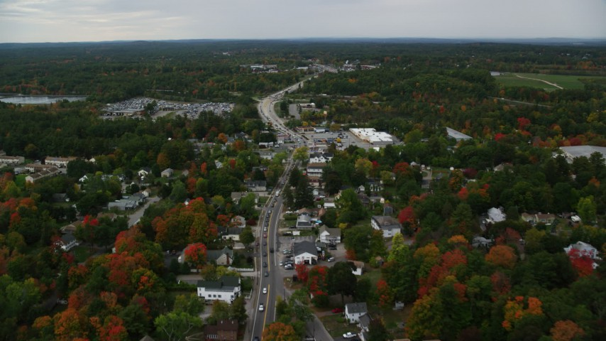 6K stock footage aerial video flying by neighborhoods, Broadway, car auction, autumn, Derry, New Hampshire Aerial Stock Footage | AX152_060
