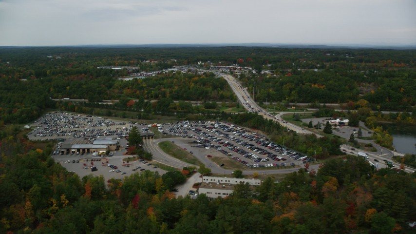 6K stock footage aerial video flying by a car auction area, autumn, overcast, Derry, New Hampshire Aerial Stock Footage | AX152_061