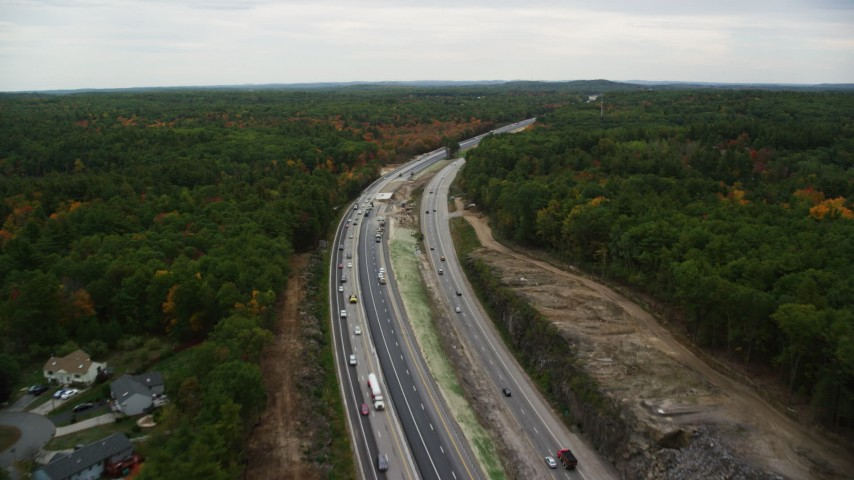 6K stock footage aerial video flying over Interstate 93, forest, autumn, overcast, Derry, New Hampshire Aerial Stock Footage | AX152_063