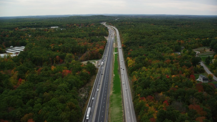 6K stock footage aerial video flying over Interstate 93, light traffic, colorful foliage, autumn, Derry, New Hampshire Aerial Stock Footage | AX152_065