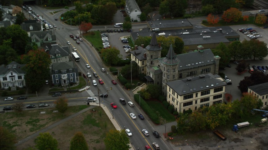 6K stock footage aerial video of a side view of a condominium complex and street, autumn, Lowell, Massachusetts Aerial Stock Footage | AX152_142
