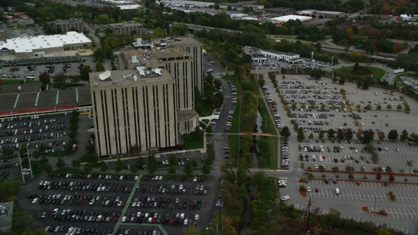 6K stock footage aerial video orbiting office building and parking lots, autumn, Lowell, Massachusetts Aerial Stock Footage | AX152_146