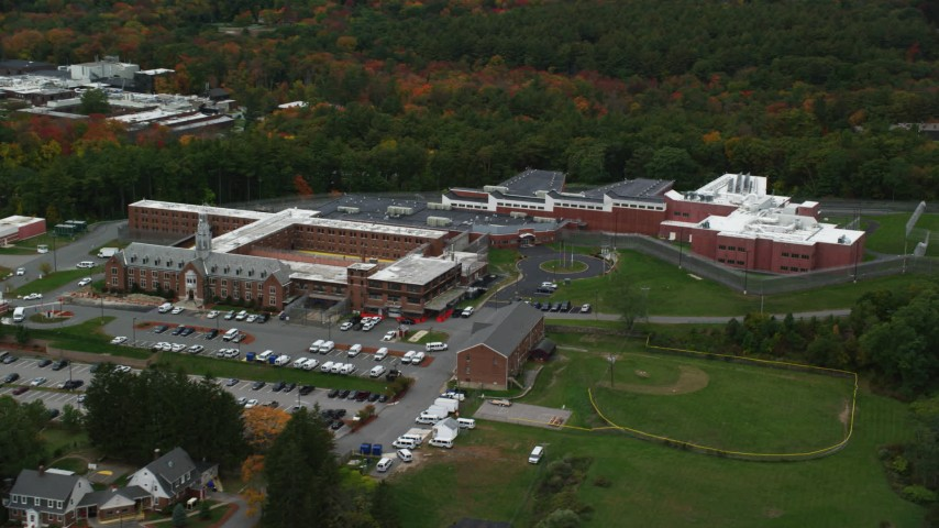 6K stock footage aerial video of a prison nestled among trees with partial fall foliage, Billerica, Massachusetts Aerial Stock Footage | AX152_159