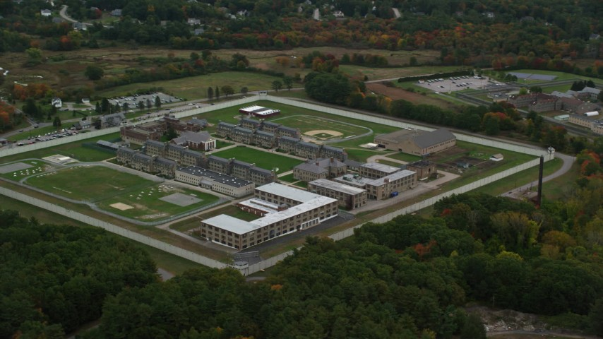 6K stock footage aerial video flying high over Massachusetts Correctional Institution at Norfolk, with autumn trees, Massachusetts Aerial Stock Footage | AX152_213