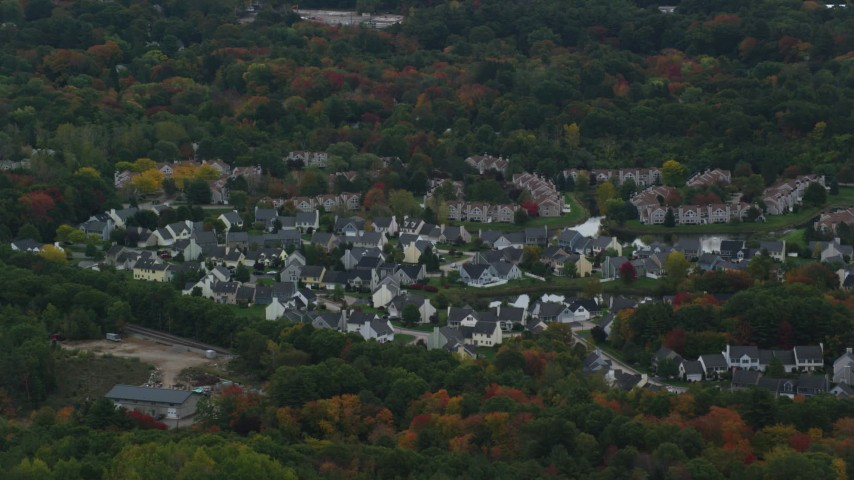 6K stock footage aerial video of suburban homes among fall foliage, Walpole, Massachusetts Aerial Stock Footage | AX152_229