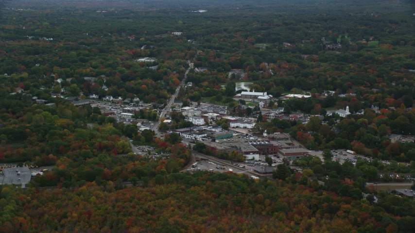 6K stock footage aerial video flying over fall foliage toward small town shops, Walpole, Massachusetts Aerial Stock Footage | AX152_230