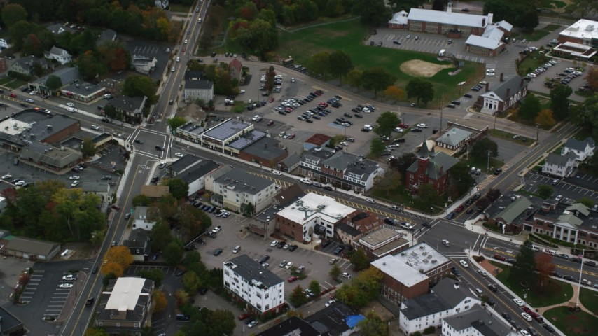 6K stock footage aerial video tilting down on shops and Main Street, Walpole, Massachusetts Aerial Stock Footage | AX152_231