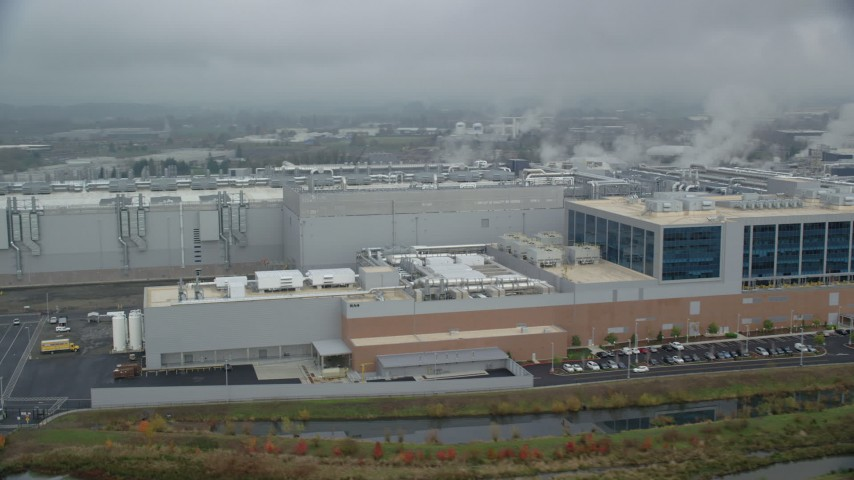 6K stock footage aerial video of the Intel manufacturing plant at Intel Ronler Acres Campus and low clouds, autumn, Hillsboro, Oregon Aerial Stock Footage | AX153_001
