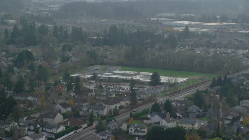 6K stock footage aerial video flying by an elementary school in autumn, Beaverton, Oregon Aerial Stock Footage | AX153_003