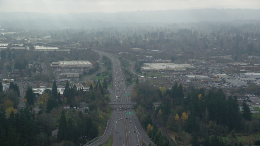 6K stock footage aerial video of Highway 217 and shopping centers in autumn with clouds, Beaverton, Oregon Aerial Stock Footage | AX153_004