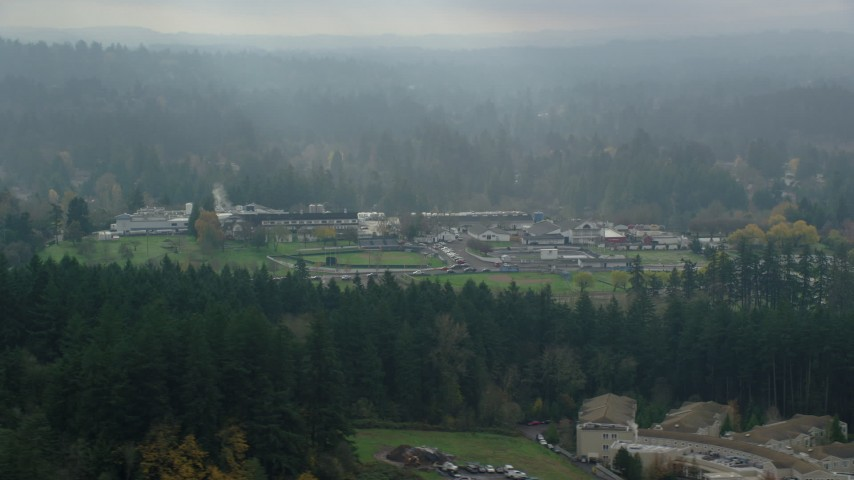 6K stock footage aerial video flying  by Alpenrose Dairy and baseball fields with godrays in autumn, Dairyville, Portland, Oregon Aerial Stock Footage | AX153_009