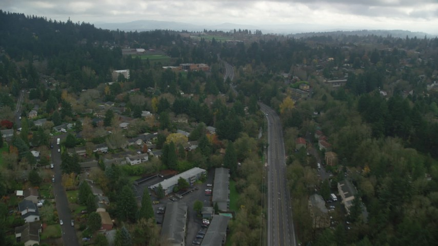 6K stock footage aerial video flying over residential area toward a hilltop preschool on a cloudy day, autumn, Portland, Oregon Aerial Stock Footage | AX153_010