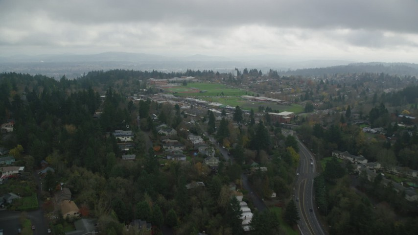 6K stock footage aerial video approaching a high school and sports fields on a cloudy day, autumn - Portland, Oregon Aerial Stock Footage | AX153_011