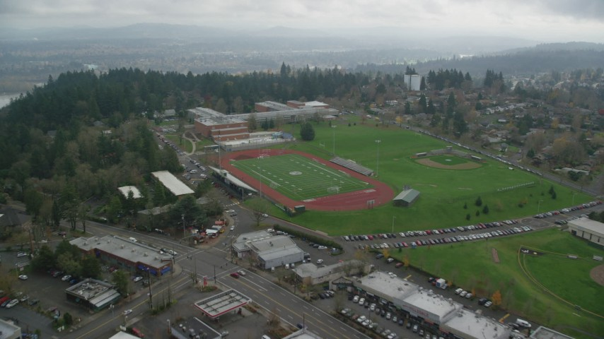 6K stock footage aerial video flying over football fields and high school, autumn, Portland, Oregon Aerial Stock Footage | AX153_012