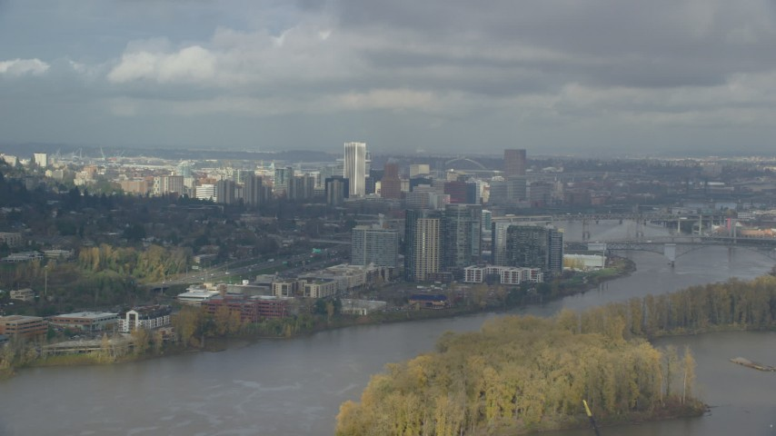 Fly over Ross Island looking at Downtown, cloudy, autumn, Southwest Portland, Oregon Aerial Stock Footage | AX153_014