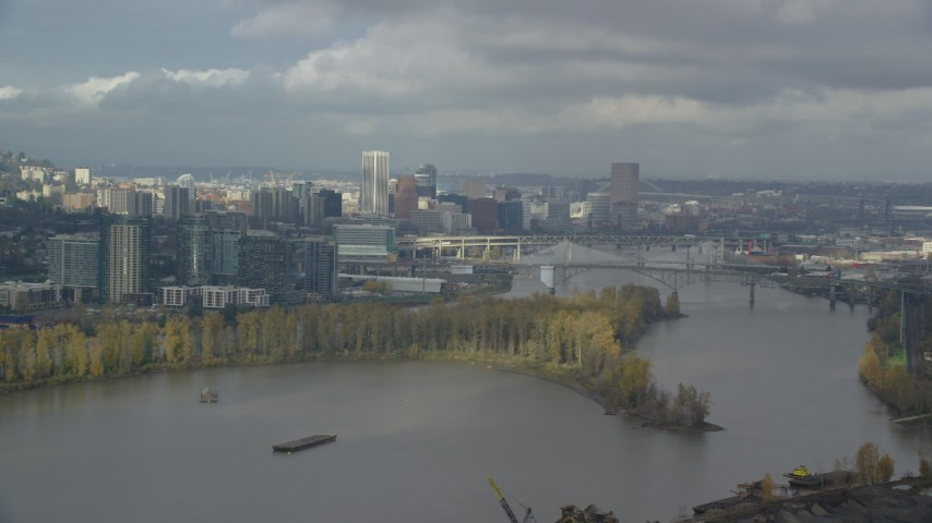 6K stock footage aerial video flying over Willamette River looking at downtown skyline, partly cloudy, autumn, Southwest Portland, Oregon Aerial Stock Footage | AX153_015