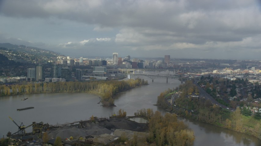 6K stock footage aerial video flying over Willamette River with downtown in background, partly cloudy, autumn, Southwest Portland, Oregon Aerial Stock Footage | AX153_016