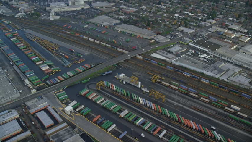 6K stock footage aerial video of a bird's eye of shipping containers at a train depot, Portland, OR Aerial Stock Footage | AX153_017