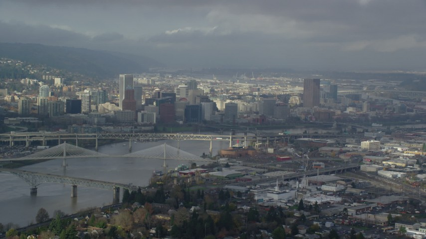 6K stock footage aerial video of the cityscape view with partly cloudy skies, Downtown Portland, Oregon Aerial Stock Footage | AX153_018