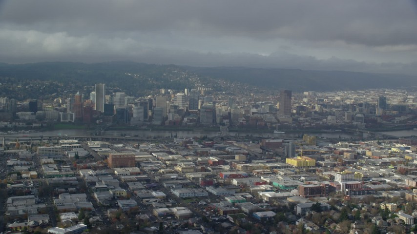6K stock footage aerial video flying over east Portland with a side view of Downtown with clouds, Portland, Oregon Aerial Stock Footage | AX153_021