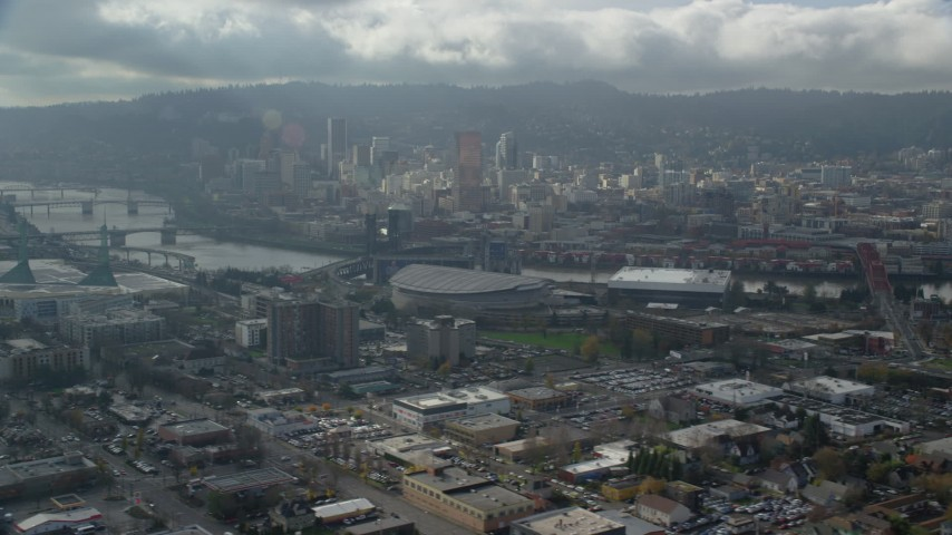 6K stock footage aerial video of Moda Center and Downtown Portland in background, cloudy, Portland, Oregon Aerial Stock Footage | AX153_025