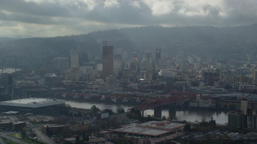 6K stock footage aerial video flying along river with views of Downtown, Portland, Oregon Aerial Stock Footage | AX153_026