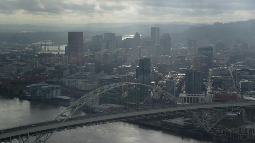 Pass by Fremont Bridge toward Downtown Portland, Oregon Aerial Stock Footage | AX153_028