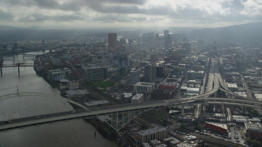 6K stock footage aerial video flying over Willamette River toward Downtown Portland, Oregon Aerial Stock Footage | AX153_029