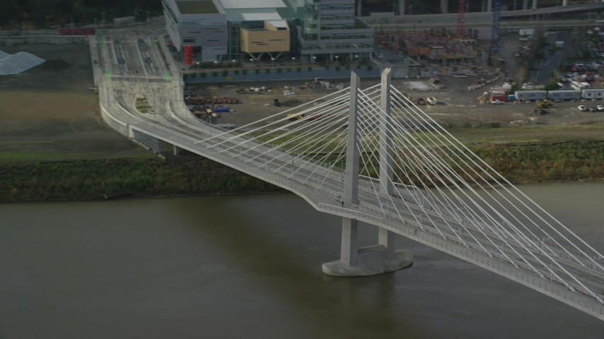 6K stock footage aerial video flying away from Tilikum Crossing, cable stayed bridge, Downtown Portland, Oregon Aerial Stock Footage | AX153_035