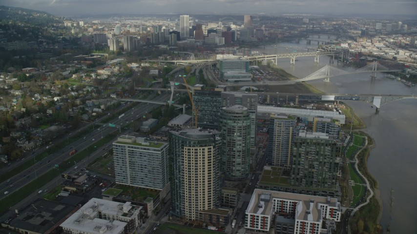 6K stock footage aerial video flying over high-rises in South Waterfront and Interstate 5 toward Downtown Portland, Oregon Aerial Stock Footage | AX153_036