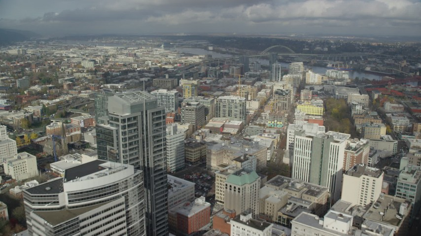 6K stock footage aerial video flying over city buildings toward Fremont Bridge, Downtown Portland, Oregon Aerial Stock Footage   AX153_039