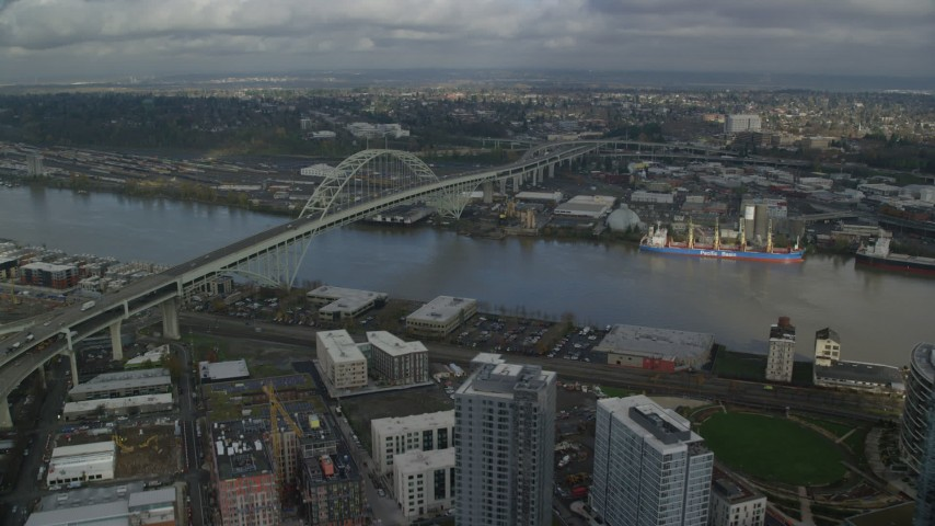 Fly along Interstate 405 and Fremont Bridge, Downtown Portland, Oregon Aerial Stock Footage | AX153_041