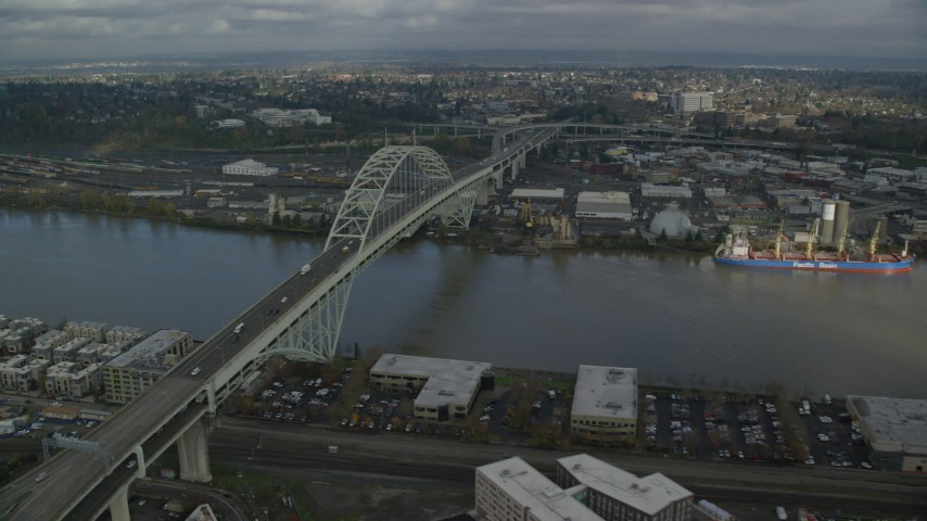 6K stock footage aerial video flying by the Fremont Bridge spanning Willamette River, Portland, Oregon Aerial Stock Footage   AX153_042