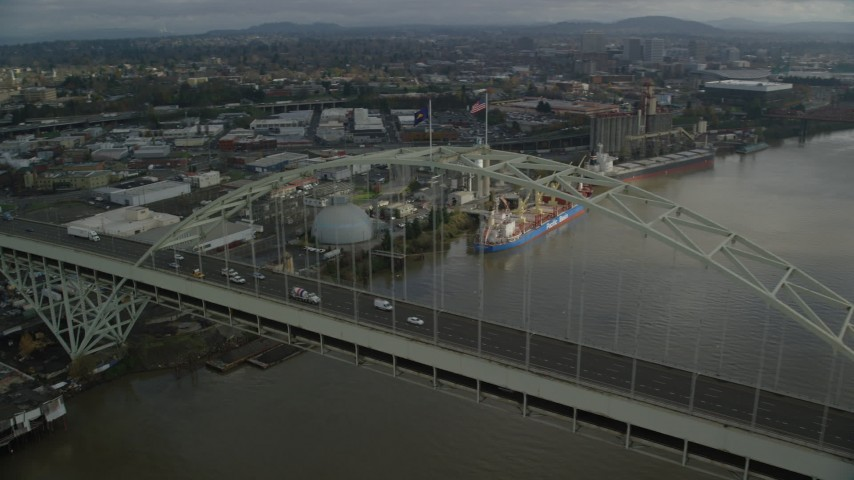 6K stock footage aerial video orbiting top of Fremont Bridge revealing Downtown Portland, Oregon Aerial Stock Footage | AX153_043